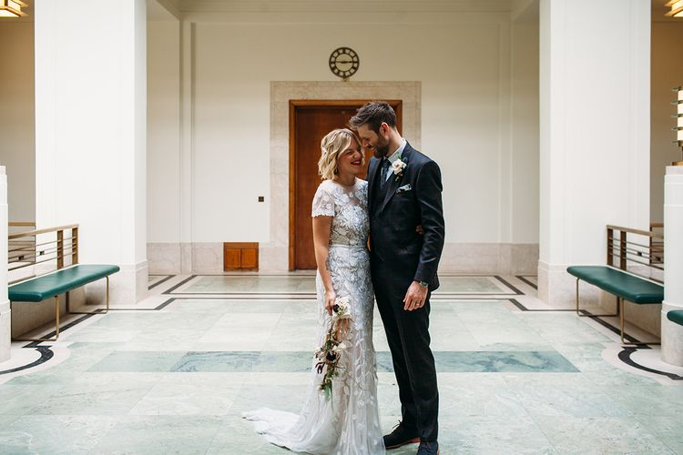 Bride in Lace Hermione De Paula Wedding Dress and Groom in Ted Baker Suit at Hackney Town Hall