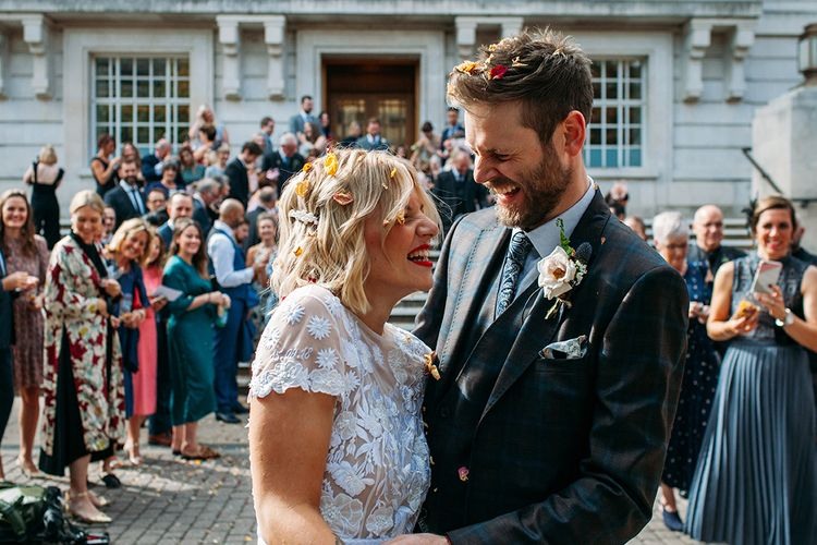 Confetti Moment with Bride in Lace Hermione De Paula Wedding Dress and Groom in Ted Baker Suit