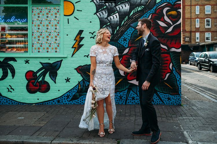 Bride in Lace Hermione De Paula Wedding Dress and Groom in Ted Baker  Laughing Together