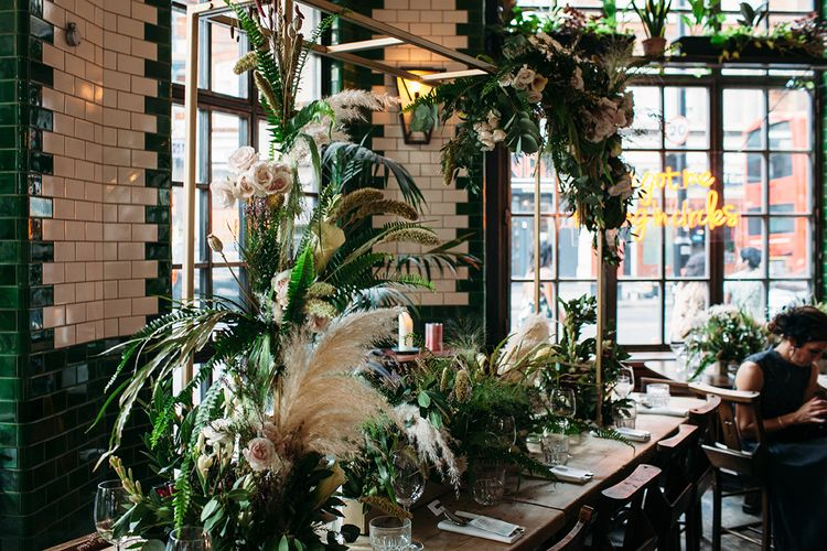 Botanical Wedding Flowers at Singer Tavern with White Roses, Foliage and  Pampas Grass