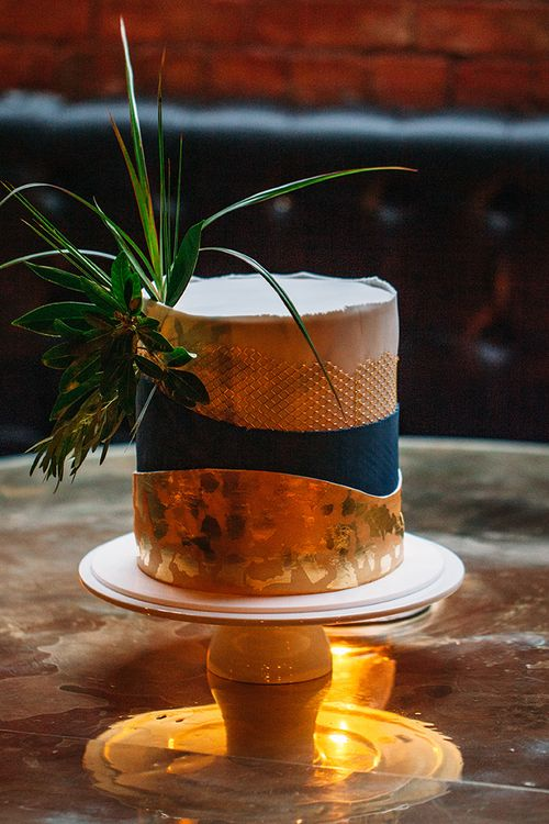 Single Tier Wedding Cake with Gold Leaf Decor  and Foliage Topper