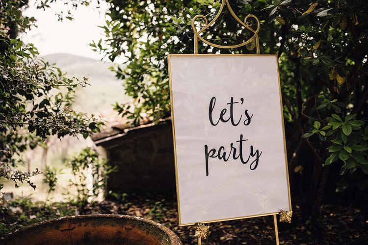 Let's Party Wedding Sign in Gold Frame | Stylish Tuscan Wedding at Vignamaggio Planned by The Wedding Boutique Italy | Samuel Docker Photography | Paul Vann Films