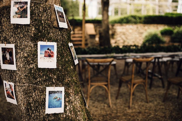 Polaroid Pictures Hung Around a Tree | Wedding Decor | Stylish Tuscan Wedding at Vignamaggio Planned by The Wedding Boutique Italy | Samuel Docker Photography | Paul Vann Films