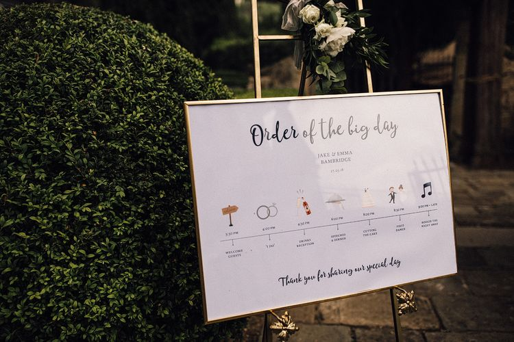Order of The Day Wedding Sign in Gold Frame | Stylish Tuscan Wedding at Vignamaggio Planned by The Wedding Boutique Italy | Samuel Docker Photography | Paul Vann Films
