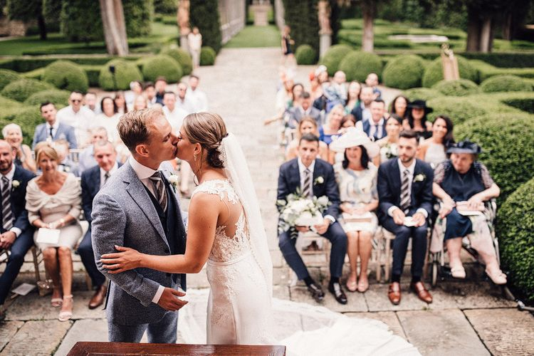 Outdoor Wedding Ceremony | Bride in Pronovias Wedding Dress | Groom in Light Blue Suit Supply Suit | Stylish Tuscan Wedding at Vignamaggio Planned by The Wedding Boutique Italy | Samuel Docker Photography | Paul Vann Films