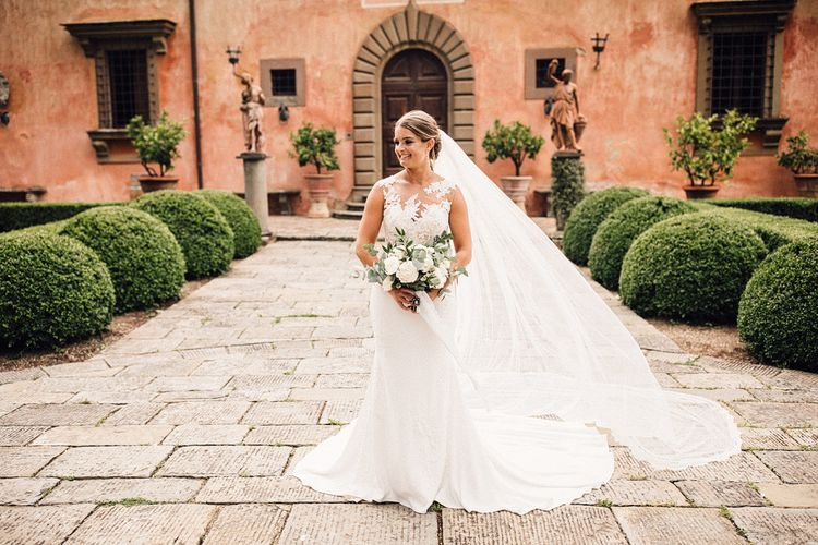 Beautiful Bride in Lace Pronovias Wedding Dress & Veil with White Peony Bouquet | Stylish Tuscan Wedding at Vignamaggio Planned by The Wedding Boutique Italy | Samuel Docker Photography | Paul Vann Films