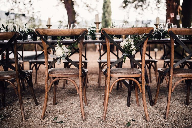 White & Green Chair Back Flowers | Stylish Tuscan Wedding at Vignamaggio Planned by The Wedding Boutique Italy | Samuel Docker Photography | Paul Vann Films