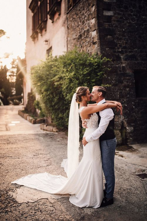 Bride in Pronovias Wedding Dress | Groom in Light Blue Suit Supply Suit | Stylish Tuscan Wedding at Vignamaggio Planned by The Wedding Boutique Italy | Samuel Docker Photography | Paul Vann Films