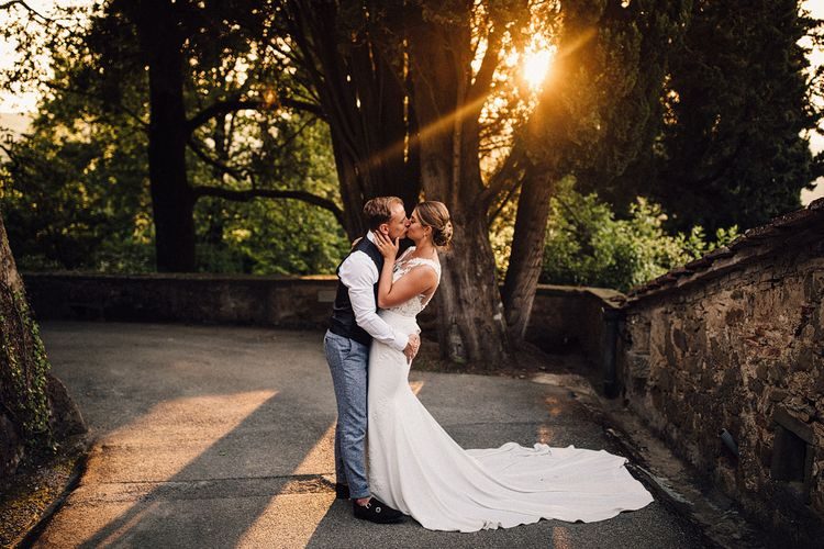 Sunset Portrait | Bride in Pronovias Wedding Dress | Groom in Light Blue Suit Supply Suit | Stylish Tuscan Wedding at Vignamaggio Planned by The Wedding Boutique Italy | Samuel Docker Photography | Paul Vann Films