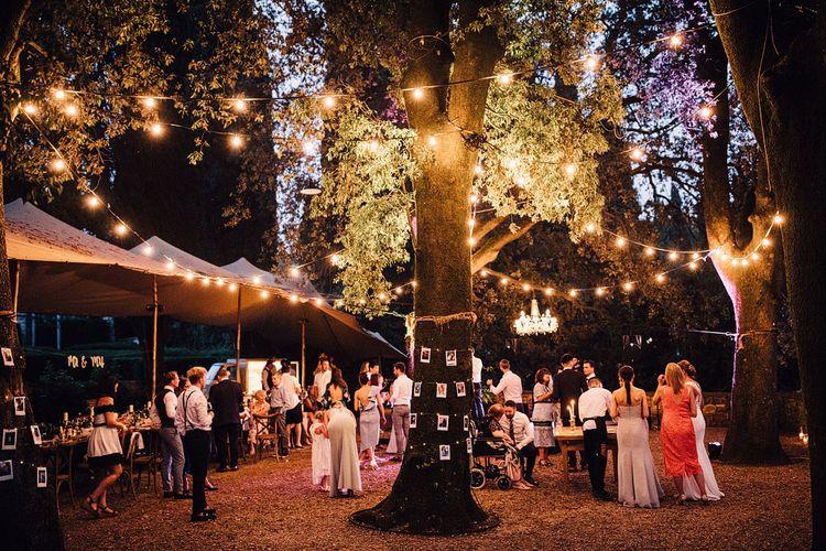 Outdoor Festoon Light Reception | Stylish Tuscan Wedding at Vignamaggio Planned by The Wedding Boutique Italy | Samuel Docker Photography | Paul Vann Films