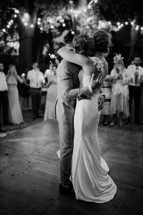 First Dance | Bride in Pronovias Wedding Dress | Groom in Light Blue Suit Supply Suit | Stylish Tuscan Wedding at Vignamaggio Planned by The Wedding Boutique Italy | Samuel Docker Photography | Paul Vann Films