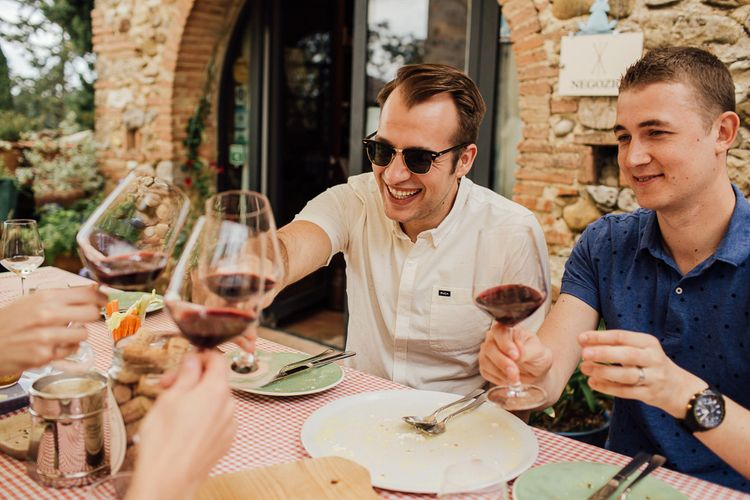 Wine tasting in the morning for the boys. Destination wedding in Italy. Featuring RMW The List recommended suppliers Wiskow & White and Red on Blonde. Rue de Seine wedding gown with deep red chianti bridesmaid Rewritten dresses.