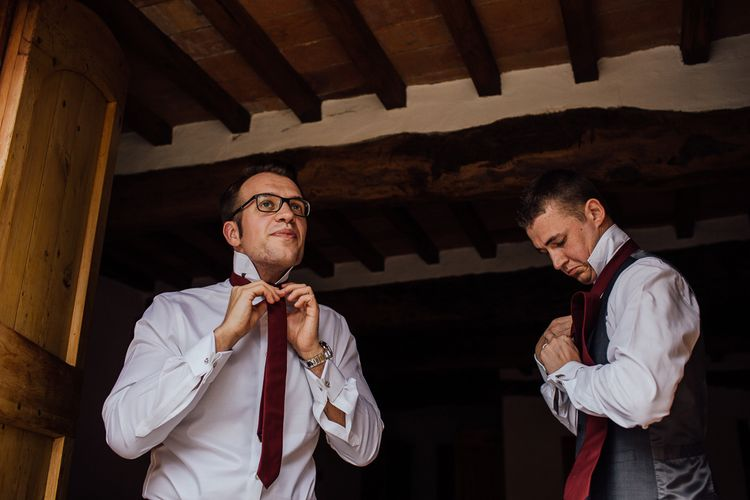 Groom's morning preparations. Destination wedding in Italy. Featuring RMW The List recommended suppliers Wiskow & White and Red on Blonde. Rue de Seine wedding gown with deep red chianti bridesmaid Rewritten dresses.