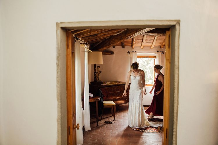 Brides morning preparation. Destination wedding in Italy. Featuring RMW The List recommended suppliers Wiskow & White and Red on Blonde. Rue de Seine wedding gown with deep red chianti bridesmaid Rewritten dresses.