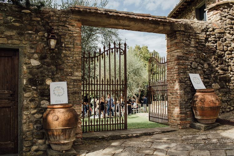 Castle Venue, Castello di Bibbione. Destination wedding in Italy. Featuring RMW The List recommended suppliers Wiskow & White and Red on Blonde. Rue de Seine wedding gown with deep red chianti bridesmaid Rewritten dresses.