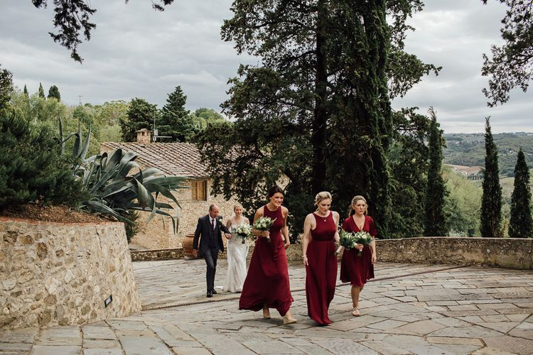 Destination wedding in Italy. Featuring RMW The List recommended suppliers Wiskow & White and Red on Blonde. Rue de Seine wedding gown with deep red chianti bridesmaid Rewritten dresses.