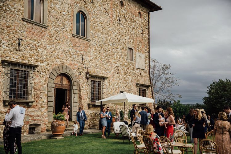 Castle grounds. Destination wedding in Italy. Featuring RMW The List recommended suppliers Wiskow & White and Red on Blonde. Rue de Seine wedding gown with deep red chianti bridesmaid Rewritten dresses.
