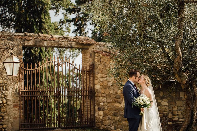 Married in Italy. Destination wedding in Italy. Featuring RMW The List recommended suppliers Wiskow & White and Red on Blonde. Rue de Seine wedding gown with deep red chianti bridesmaid Rewritten dresses.