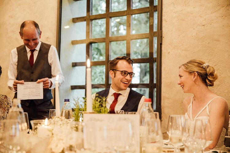 Toasts. Destination wedding in Italy. Featuring RMW The List recommended suppliers Wiskow & White and Red on Blonde. Rue de Seine wedding gown with deep red chianti bridesmaid Rewritten dresses.