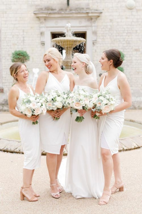 Bridal party with bridesmaids in white dresses