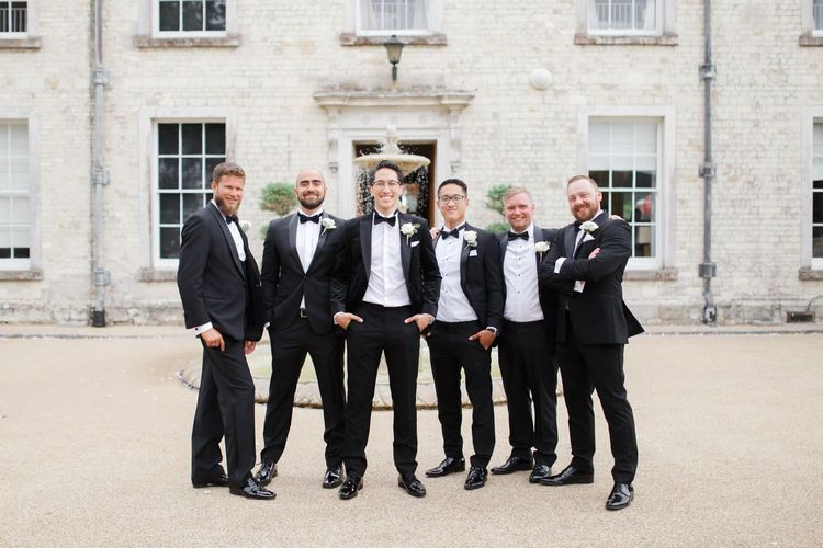 Groomsmen in tuxedos and bow ties at Froyle Park