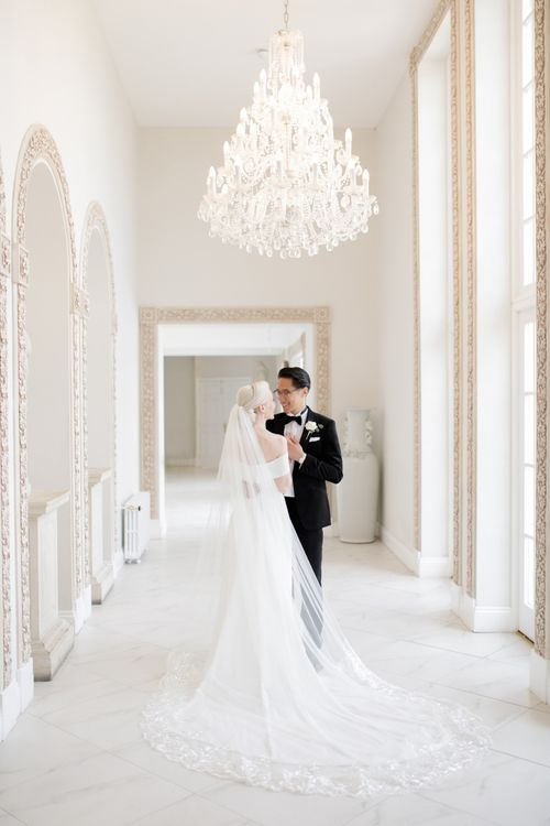 Bride in Mori Lee wedding dress and cathedral length veil