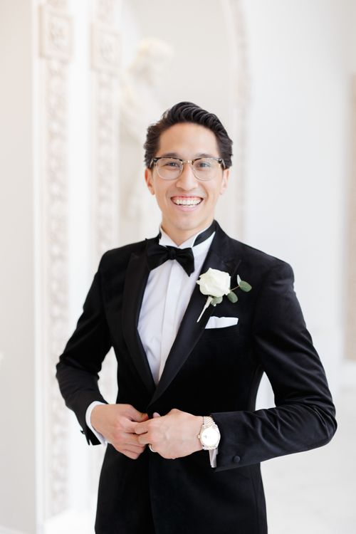 Groom in black tie suit and bow tie