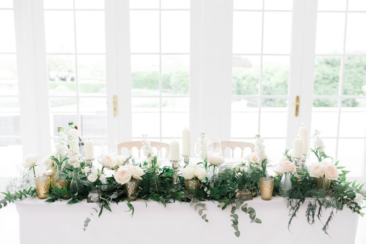 Top table white and green wedding flowers