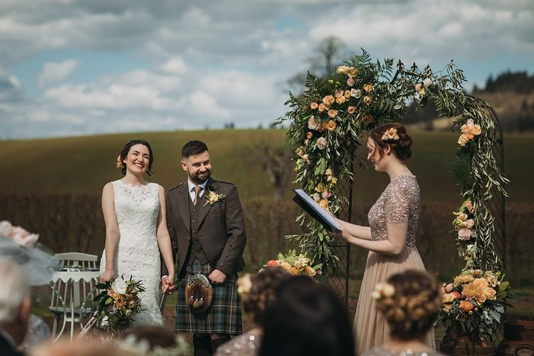 Floral Arch For Wedding Ceremony // The Tin Shed At Knockraich Farm Rustic Wedding With Bridesmaids In Maya ASOS Sequin And Tulle Dresses With Images From Jo Donaldson Photography