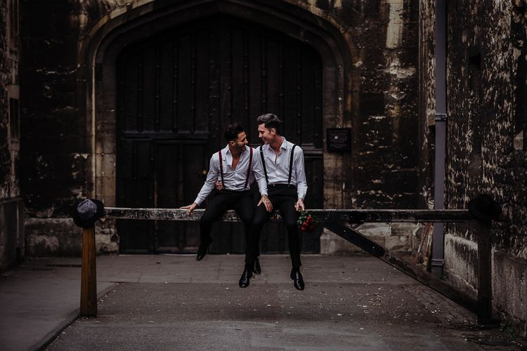 Gay couple engagement shoot with matching outfits by Cat Stephens Photography
