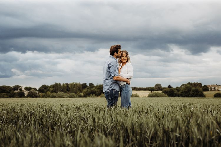 Casual engagement shoot in field by Cat Stephens Photography