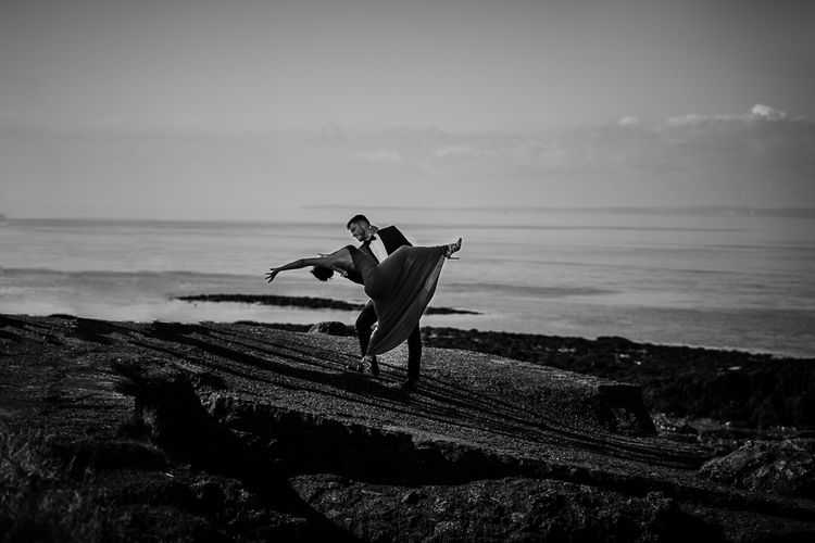 Black tie engagement shoot on the beach by Cat Stephens Photography