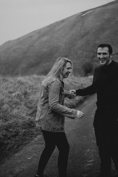 Casual couple engagement shoot hillside by Emily Rose Photography
