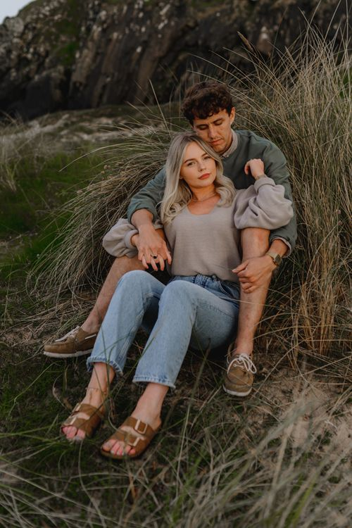 Casual couple on beach engagement photos by LIT Photography