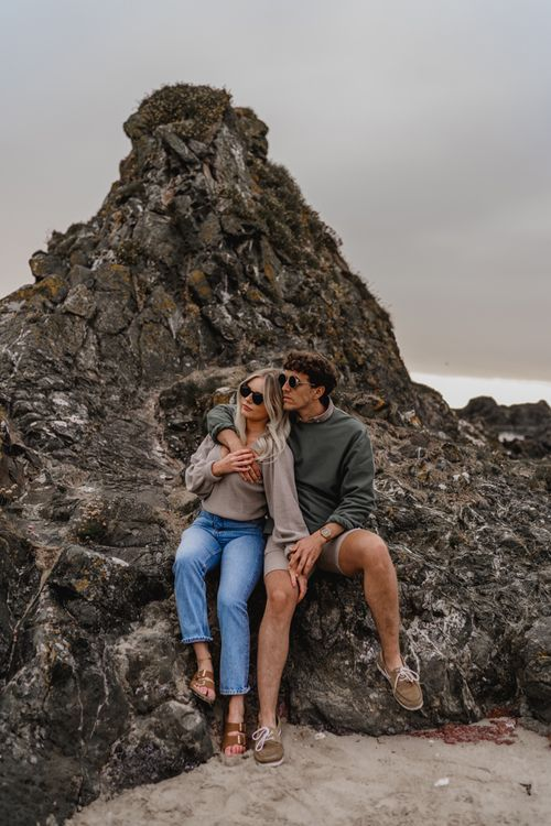 Casual couple on beach engagement shoot by LIT Photography