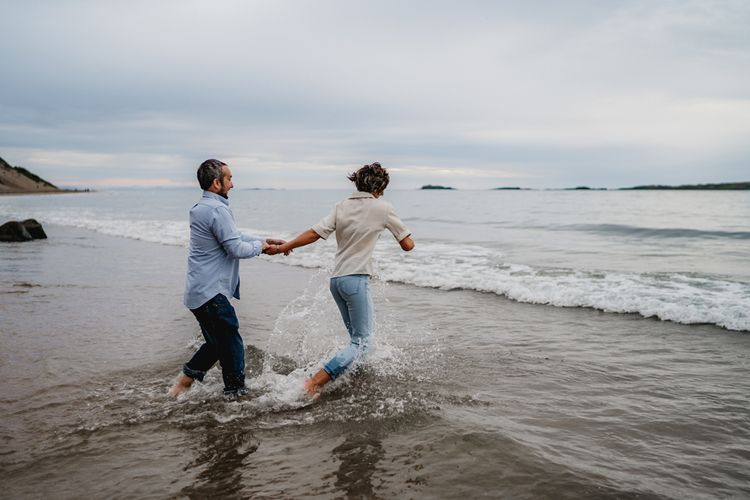Casual beach engagement photos by LIT Photography