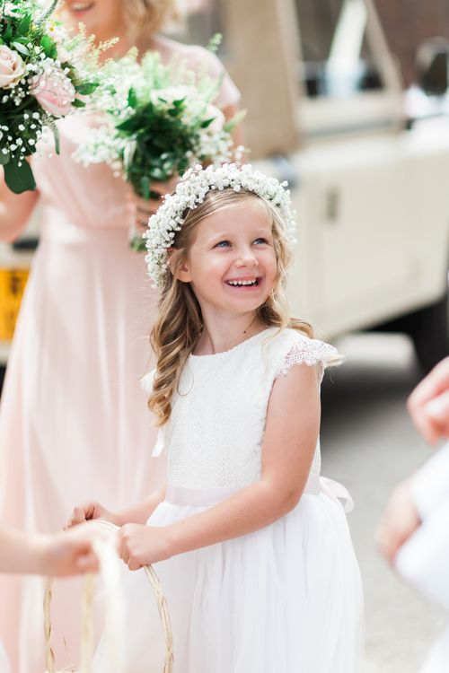 Cute Flower Girl with Gypsophila Flower Crown | Pink ASOS Bridesmaid Dresses | Pink & White At Home Marquee Wedding by Pretty Creative Styling | Jo Bradbury Photography
