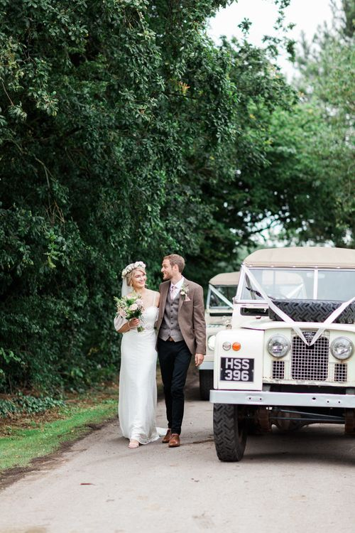 Land Rover Wedding Car | Bride in Bespoke Felicity Cooper Bridal Gown | Pink & White At Home Marquee Wedding by Pretty Creative Styling | Jo Bradbury Photography