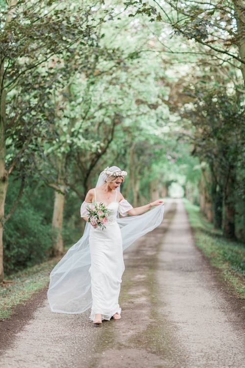 Bride in Bespoke Felicity Cooper Bridal Gown | Pink ASOS Bridesmaid Dresses | Pink & White At Home Marquee Wedding by Pretty Creative Styling | Jo Bradbury Photography