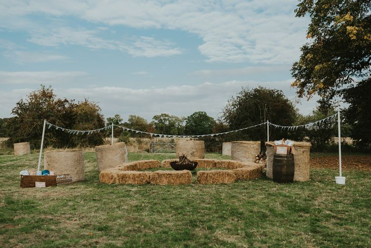 Haybale Seating For Wedding Reception // Family Home Wedding In The Cotswolds With Vintage Porsche Tractor Bride In Grace Loves Lace Bridesmaids In White Dresses Images Virginia Photography
