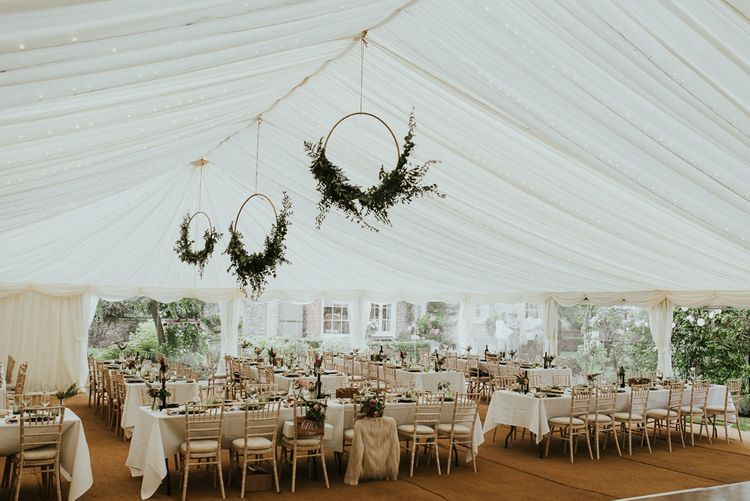 Foliage Hoop Wedding Decor // Family Home Wedding In The Cotswolds With Vintage Porsche Tractor Bride In Grace Loves Lace Bridesmaids In White Dresses Images Virginia Photography