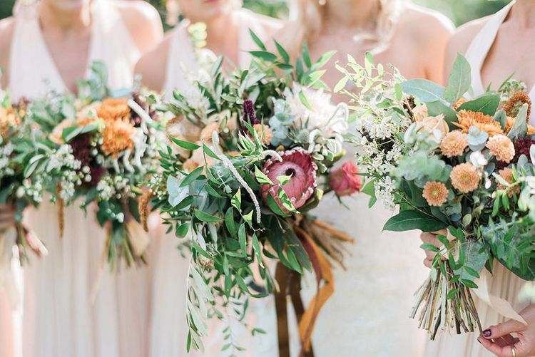 Protea Wedding Bouquets // Macrame Ceremony Backdrop Rustic Hippie Wedding The Great Barn Dream Catchers And Oversized Florals Bride In Essence Of Australia Images Kathryn Hopkins