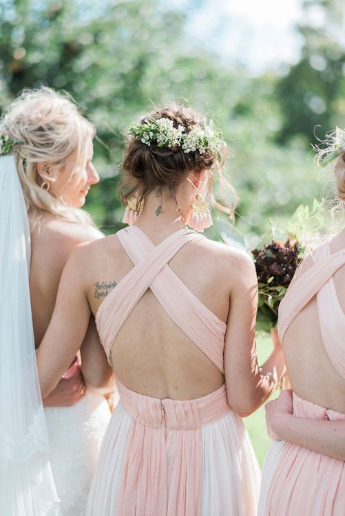 Bridesmaids In Pale Pink Dresses // Macrame Ceremony Backdrop Rustic Hippie Wedding The Great Barn Dream Catchers And Oversized Florals Bride In Essence Of Australia Images Kathryn Hopkins