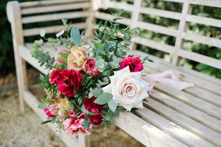 Bridal Bouquet With Pale Pink Roses And Berry Coloured Anemones