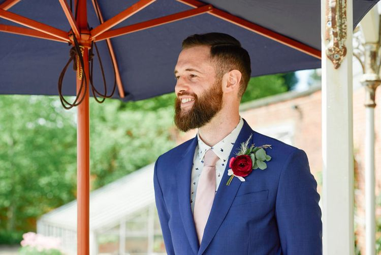 Groom In Navy Suit By Paul Smith With Pink Tie
