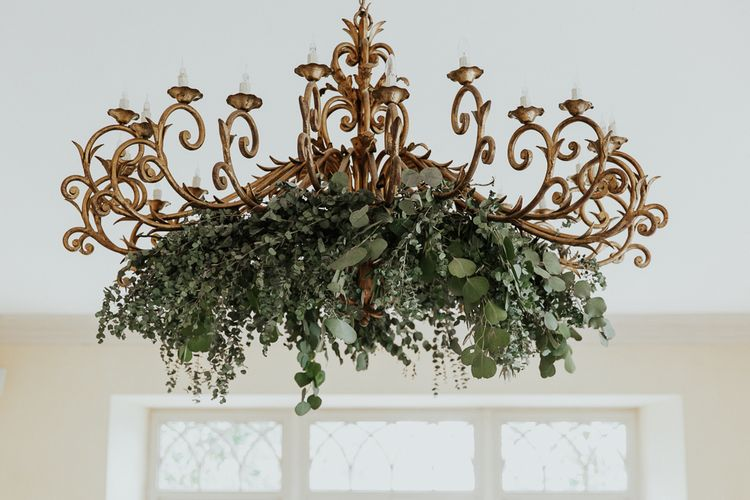 Chandelier Covered in Foliage and Ferns