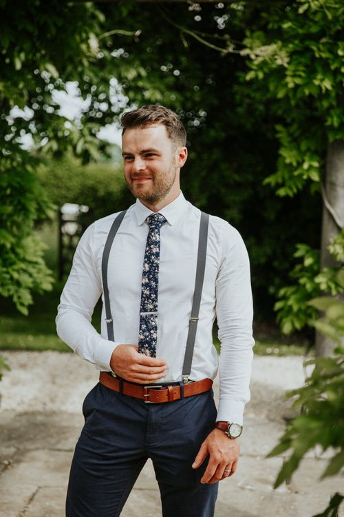Groom in Navy Chino's, Braces and Floral Tie