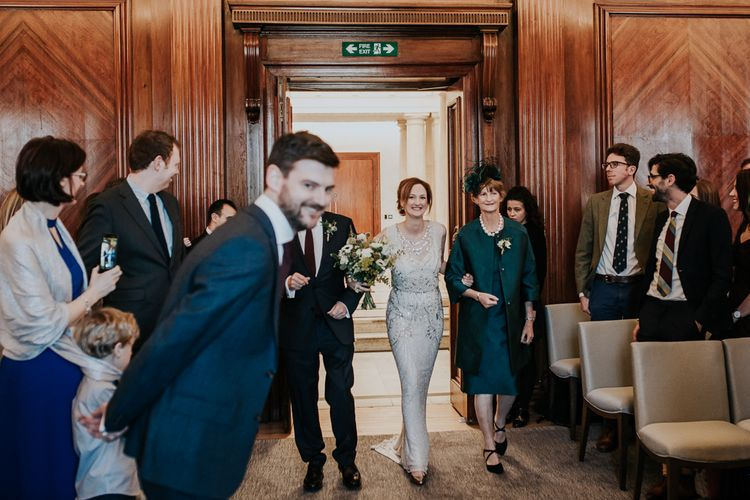 Wedding Ceremony at Old Marylebone Town Hall | Bridal Entrance in Jenny Packham Esme Gown | Groom at the altar in Navy Ted Baker Suit | Navy & Silver Winter Wedding in London | Joasis Photography