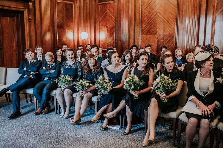 Wedding Ceremony at Old Marylebone Town Hall | Bridesmaids in High Street Navy Dresses | Navy & Silver Winter Wedding in London | Joasis Photography