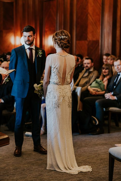 Wedding Ceremony at Old Marylebone Town Hall | Bride in Jenny Packham Esme Gown | Groom in Navy Ted Baker Suit | Navy & Silver Winter Wedding in London | Joasis Photography